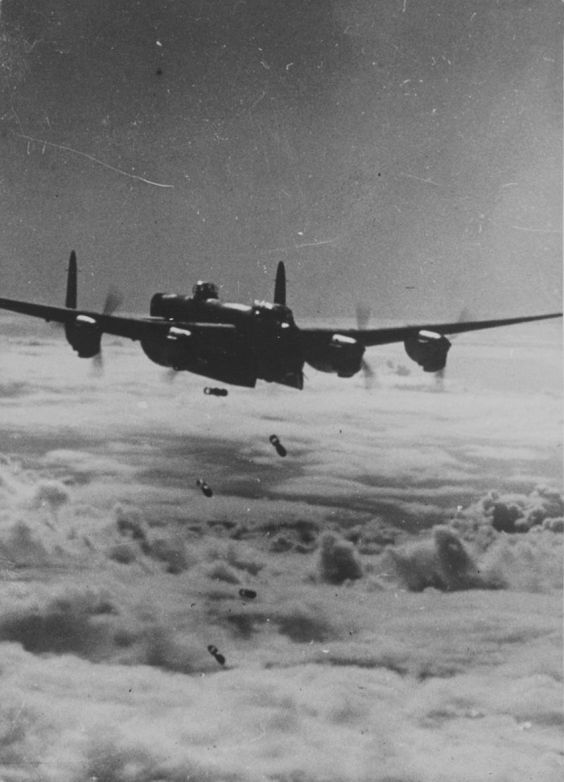 British Bomber 'Lancaster' (Avro Lancaster) dropping bombs over the target.