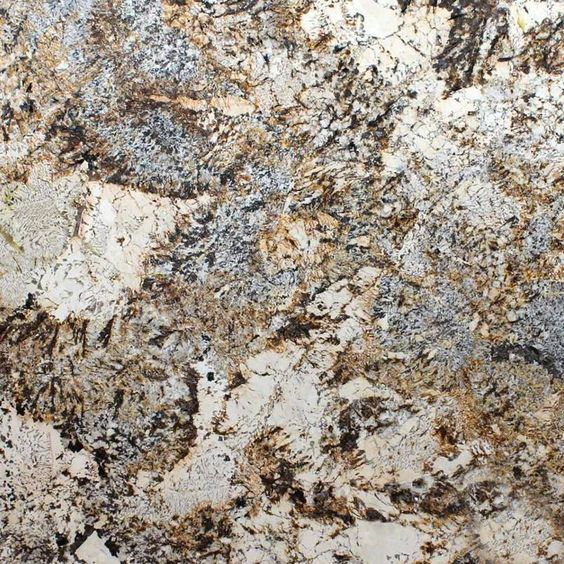 CARAVELAS GOLD GRANITE Caravelas Gold Granite countertops are dramatic, and stunning. Soft creams swirl together with warm browns and cool grays in this high movement natural granite. 2 CM and 3 CM s