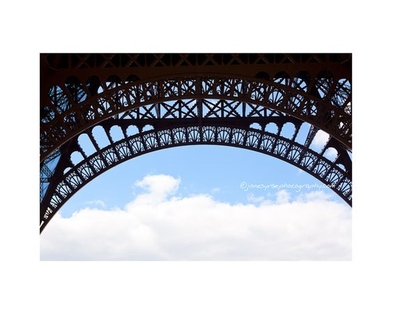 Cool detail and sky shot of the Eiffel Tower.