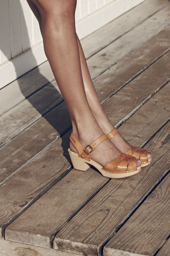 Swedish Hasbeens // Cool and quirky clogs with effortless 70s style. These cute sandals are handmade from natural grain leather and wood. Designed with a peep toe, woven leather upper, and a flirty ankle strap. The supple tan color pairs perfectly with your favorite jeans, shorts, and dresses.
