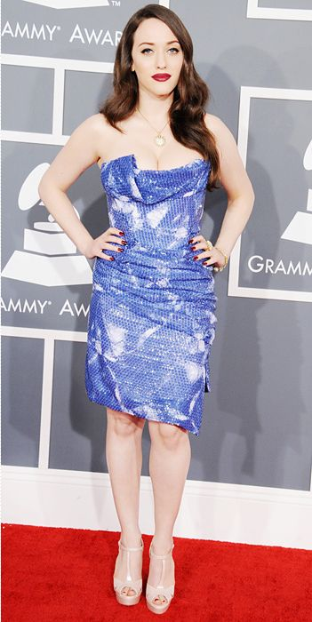 Presenter Kat Dennings at the 2103 Grammy Awards chose a sequined sky blue and white Vivienne Westwood cocktail dress for the red carpet. She completed her look with David Yurman's Starburst pendant, ring and linked bracelet and a deep red lip.