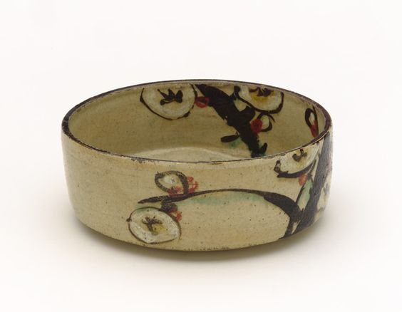 Kenzan-style food dish with design of plum, late 18th to early 19th century.   Kyoto workshop, Kenzan style. Edo period. Buff clay; white slip, iron pigment, and enamels under transparent glaze. H: 5.2 W: 13.3 cm. Kyoto, Japan.
