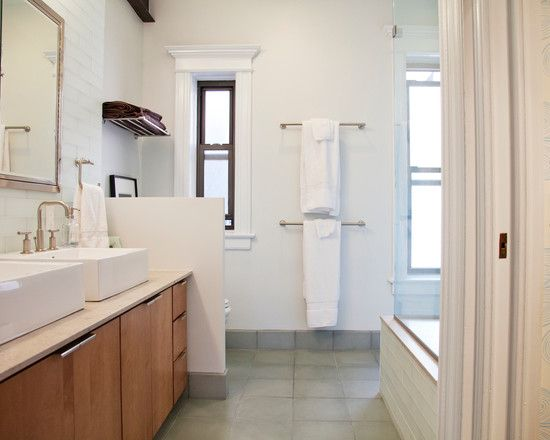 Like the stacked towel racks, the grey flooring, and the white with wood vanity.