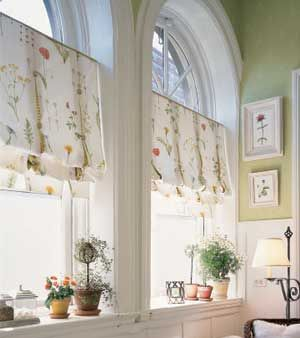 Hate the pattern/ style of these shades. But love the idea of keeping the top part of an arched window exposed, instead of covering it with curtains.: