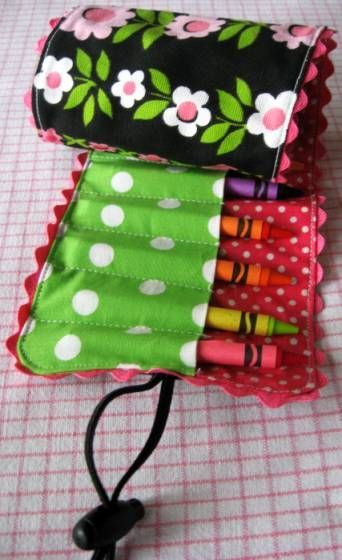 I like the way this one closes around. A pretty good tutorial too. I want to make these (only with a flap to fold over the top to hold them in) I'll make one for markers, twisty crayons, and one for colored pencils...OH! And one for knitting needles, crochet hooks....the uses goes on and on!  FUN!