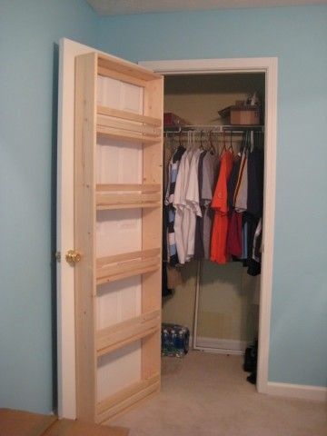shelves attached to the inside of a closet door... Shoes/purses...could be great for a linen closet to hold soaps, lotions