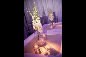 At the Friday night party, the decor was clean and simple, with touches like white dendrobium orchids in cylinders with glass beads at the base, flanked by candles.