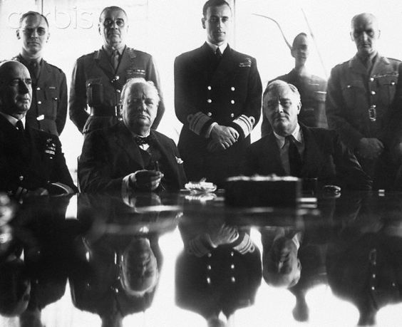 Allied Conference - NA002055 - Rights Managed - Stock Photo - Corbis. An allies grand-strategy conference in North Africa. Sitting left to right are: Adm. E. J. King; Sir Winston Churchill; President Roosevelt; Standing: Maj. Gen. Sir Hastings Ismay; Lord Louis Mountbatten; and Field Marshall Sir John Dill. 1943.