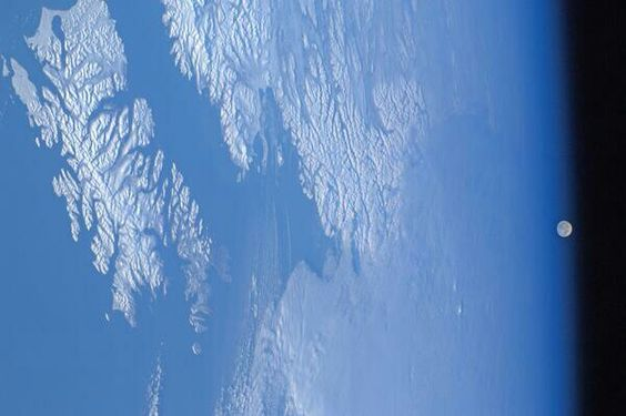 7/13/14 Earth's moon rising over Southwestern Alaska.