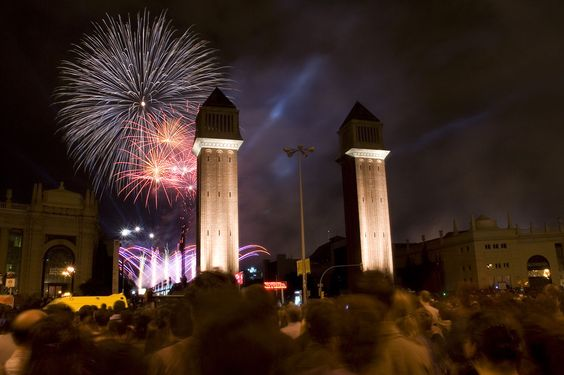 Celebrating La Merce with a great fireworks show.  Venecian Towers in foreground, Barcelona, Spain