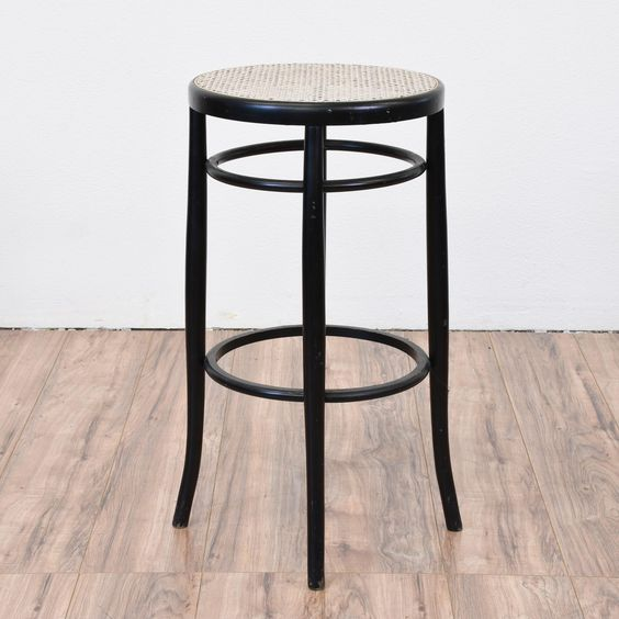 Made in Italy, this tall stool is just the right size for a bar height table! Slender in stature, the cane seating is in great shape. The stool is finished in a black paint. A great addition to any dining set. Please see photos for more details.   #traditional #chairs #stool #sandiegovintage #vintagefurniture