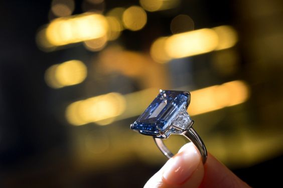 The Oppenheimer Blue diamond has been sold for a historic $57.5 million,  at a Christie's auction in Geneva
