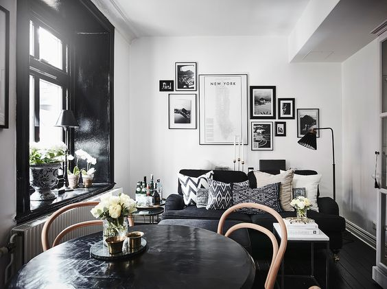 cosy combined living and dining room with black floors and windows, via http://www.scandinavianlovesong.com/
