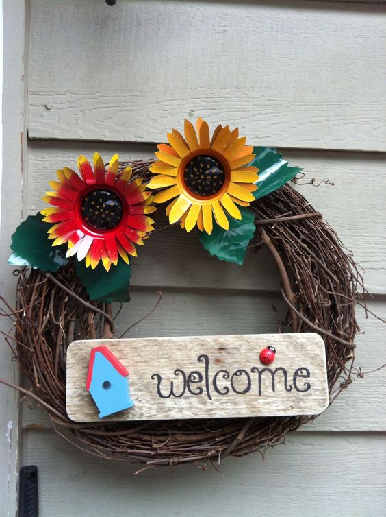 Autumn wreath ... Beautifully made from recycled soda cans and pallet wood!