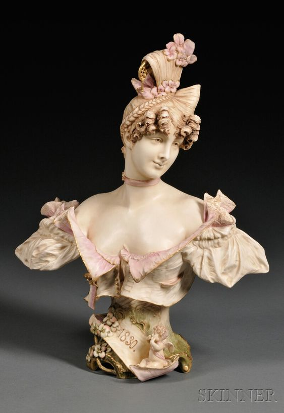 Teplitz Porcelain Bust of a Maiden, Austria, c. 1900, polychrome enameled and gilded, a ribbon inscribed 1830 to the base, printed mark.