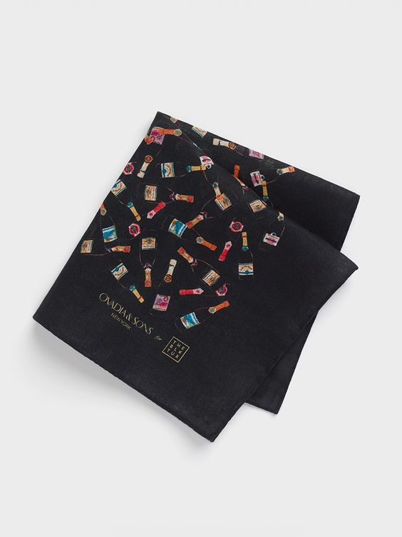 Champagne Bottle Pocket Square. This linen pocket square is the perfect way to generate buzz with your accessories. This is an exclusive piece designed by Ovadia & Sons for The Black Tux.