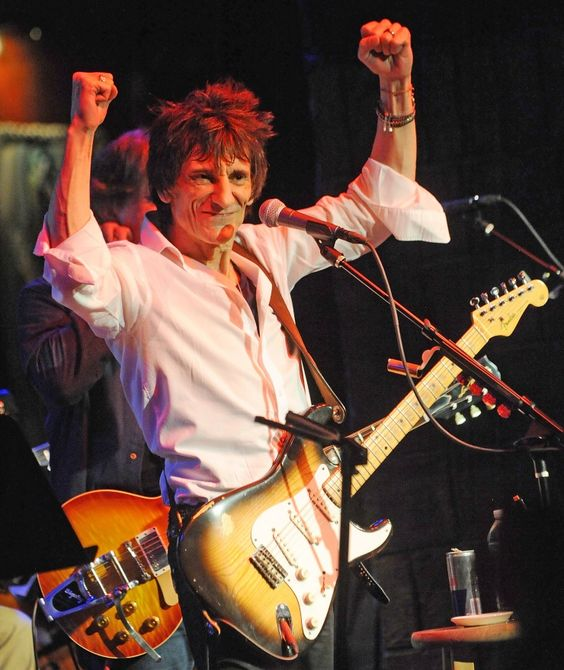 Rolling Stones' guitarist Ronnie Wood flexes his muscles during a tribute performance to blues musician Jimmy Reed on Nov. 7 in New York