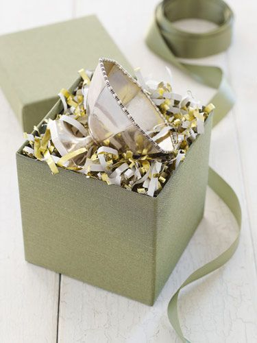 Shred your unusable cuttings of wrapping paper through a paper shredder for a colorful, resourceful alternative to bubble wrap or sheets of tissue paper.