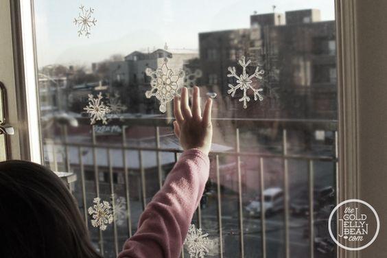 DIY Snow Flake Window Clings, via www.thegoldjellybean.com