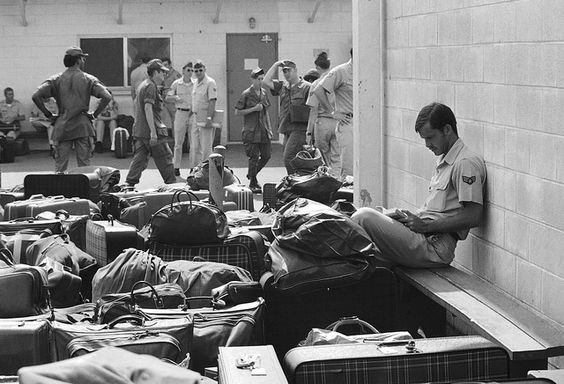 In this March 27, 1973 photo, surrounded by luggage of other departing GIs, U.S. Air Force airman reads paperback novel as he waits to begin processing at Camp Alpha on Saigon's Tan Son Nhut airbase in Saigon as troop withdrawals resume after 10 day-delay.