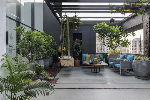 A Sprawling Penthouse In Mumbai With Hidden Doors A Stairway To Green Heaven Terrace Decor Rooftop Terrace Design Porch Design