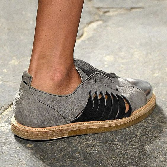 The new Syd Sneaker in grey nubuck lights up each step with a metallic toe cap and contrast twisted side slits. Look 28 from the #SS16 #runway.  #maiyet #nyfw #fashionweek #sneaker #shoes #suede #grey #nubuck #footwear #designershoes