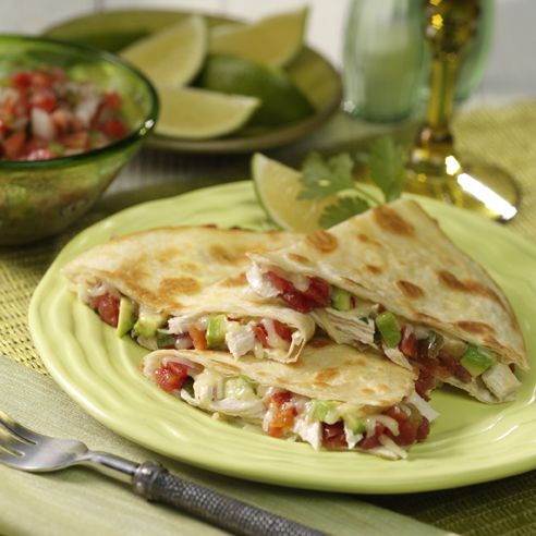 RO*TEL Mexican Quesadillas: Creamy avocado, spicy tomatoes and melted pepper jack cheese complete this traditional Mexican recipe. Add chicken and they're dinner-ready!