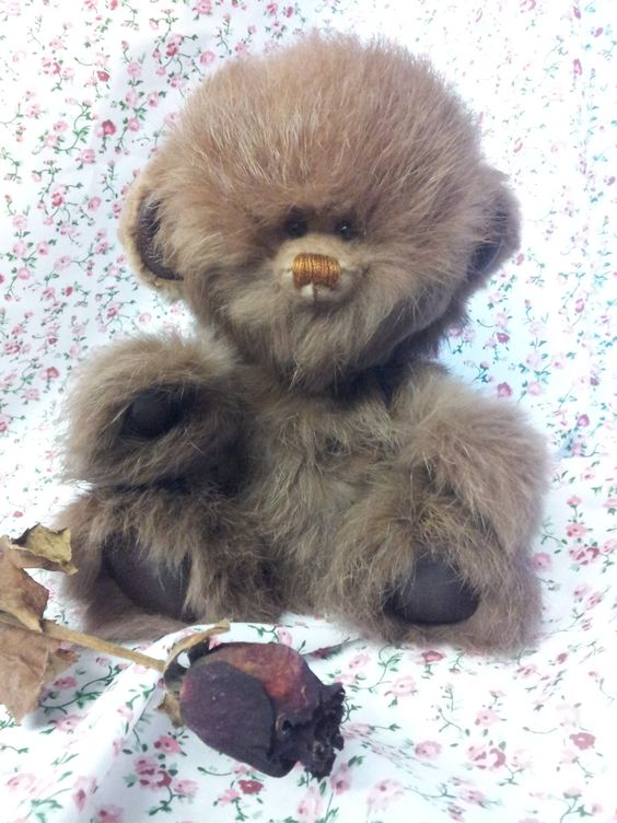 This little fellow is made by myself, from a vintage real fur coat, with leather paw pads, glass eyes and is fully jointed..For sale on ebay...