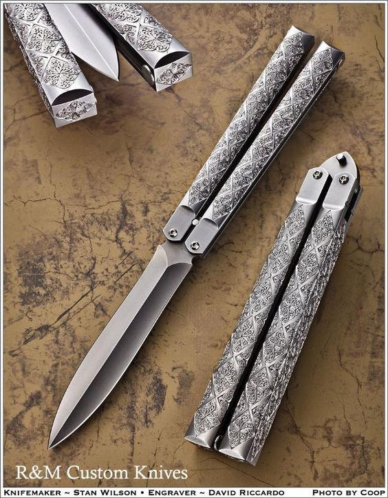 Stan Wilson Bali Engraver David Riccardo * 9 1/8 Overall Length * 5 1/8 Closed * Blade - 4, Double Edge Dagger, CPM-154, Stan Wilson Engraved On Tang * Frame - 416-SS * Magnetic Closers * David Riccardos Engraving Simply Incredible!!