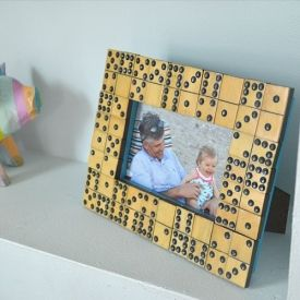 A box of flea market dominos is transformed into a charming vintage picture frame.