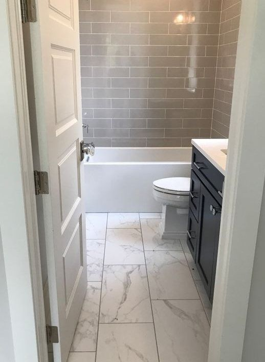 The Tile Flooring That Looks Like Marble In This Bathroom Creates A Stunning Look It Is Light And Gives Bathroomremodel In 2020 Marble Bathroom Floor Bathrooms Remodel Small Bathroom Remodel