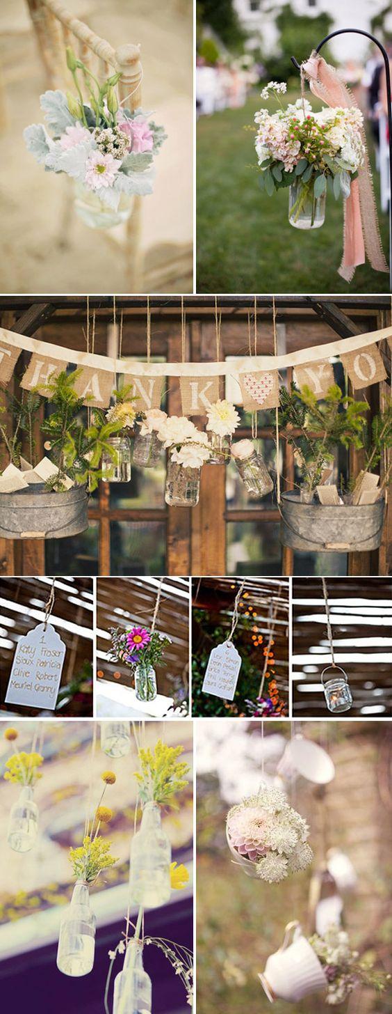Decoración con botellas de cristal y flores para bodas