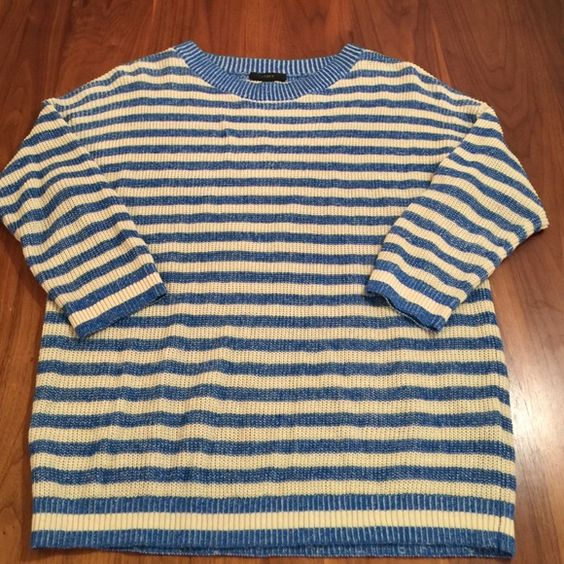 J. Crew Heather Stripe Sweater Blue and cream stripe. Meet the perfectly slouchy, slightly textured linen and cotton sweater we're wearing on chilly summer nights straight through to crisp fall days. Our designers gave a classic stripe a fresh feel with a subtle heathered effect, then tweaked the easy fit with formfitting three-quarter sleeves (so it has a flattering-for-all relaxed drape, but still feels tailored).  Relaxed fit.  Linen/cotton. J. Crew Sweaters Crew & Scoop Necks