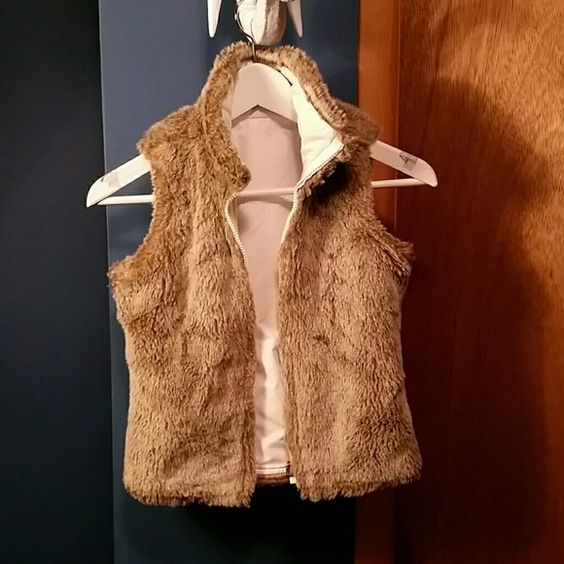 Gap faux fur reversible little girls vest In excellent condition,  little girls vest. Super cute and super soft faux fur. Two front pockets on the fabric side. GAP Jackets & Coats Vests