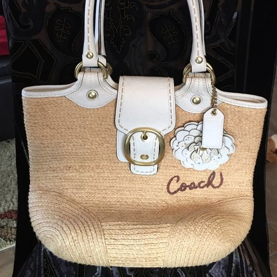 """Beautiful Coach Straw Poppy Tote - EUC! Beautiful, authentic Coach Straw Poppy Tote -  M0768-11798 - This tote has been carried a few times, but is in excellent condition, and loaded with details! The 3D flower, shiny brass hardware, elegant stamped leather, contrast stitching, and embroidered """"Coach"""" logo, combine to make a stunning bag. The interior lining is a crisp and clean plaid satin, that includes a large zip pocket, and two slip pockets. A really lovely bag for spring and summer…"""