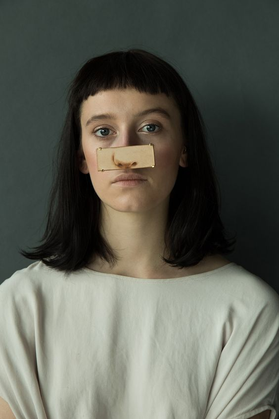 Akiko Shinzato. Piece: Putting on Someone's Identity, 2015. Brass, laser engraved leather, reflective plastic. Photo by: Runa Anzai. Model: Kitty Garrett. Hair& Makeup: Yoko Minami.: