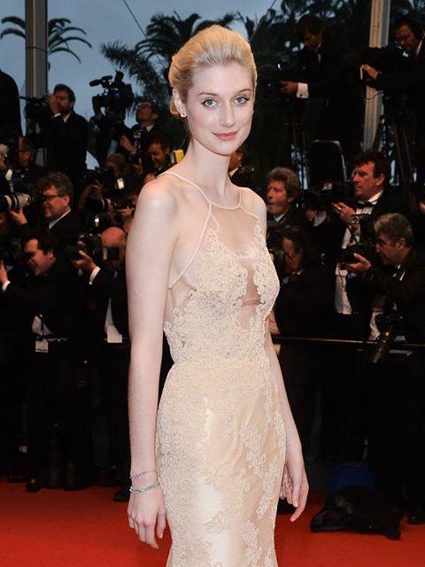 Elizabeth Debicki in nude lace dress.