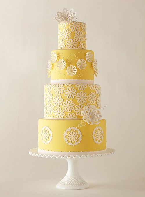 Sunshine yellow wedding cake decorated with lacy flowers. So cheery!: