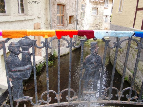 A coloured bridge with funny yet serious figures.