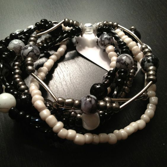 "Black, white and silver glass and metal beads. 7.5"" round."