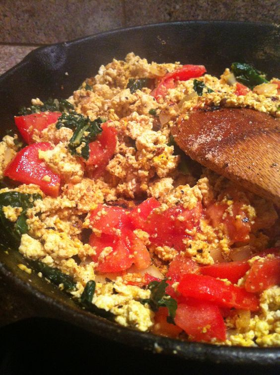 Scrambled tofu with kale, onion and tomato. Sauté chopped onion in ...