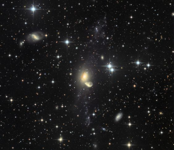 Following an ancient galaxy-galaxy collision 200 million light-years from Earth, debris from a gas-rich galaxy, NGC 5291, was flung far into intergalactic space.  - Image Credit & Copyright: CHART32 Team, Processing - Johannes Schedler