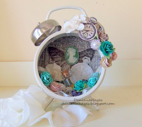 artistic transformation by Daniella Hayes altered clock altered art assemblage