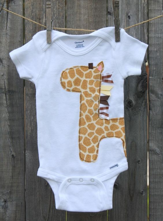 Homemade onesies are so cute.  I love the idea of using ribbons.  This could be a whale, a lion, a bird, an elephant... so many choices!: