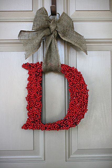 """pretty """"wreath"""" for front door.  not sure how I would hang an """"L"""", but oh well, I still like the idea.  just holly (could use other things) glued to a craft letter and tied with a bow."""