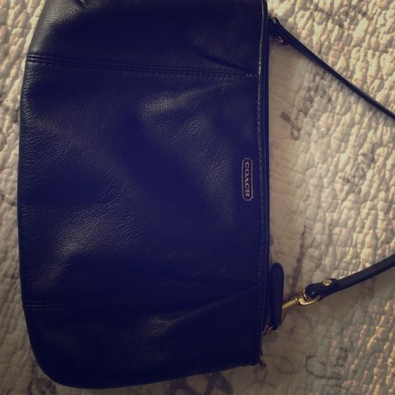 Coach small purse Excellent condition, gets leather treated every 3 months, used 3 times.   Has the deprecate compartments for cards and a larger one for a phone and a few accessories. Coach Bags Mini Bags