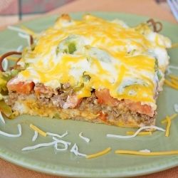 John Wayne Casserole    Ingredients  2 pounds ground beef, cooked and drained  1 (1.25-ounce) packet taco seasoning  4 ounces sour cream  4 ounces mayonnaise  8 ounces Cheddar cheese, shredded and divided  1 yellow onion, sliced  2 cups biscuit mix  2 tomatoes, sliced  1 green bell pepper, sliced  1 (4-ounce) can sliced jalapeno peppers
