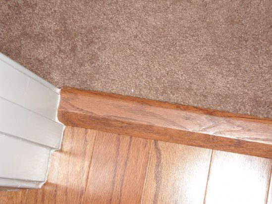 Where to place carpet to wood transition strip home for Wood floor pieces