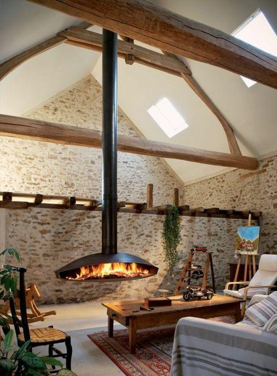 moderne kaminöfen hängender kamin wohnzimmer steinwand teppich, Deko ideen