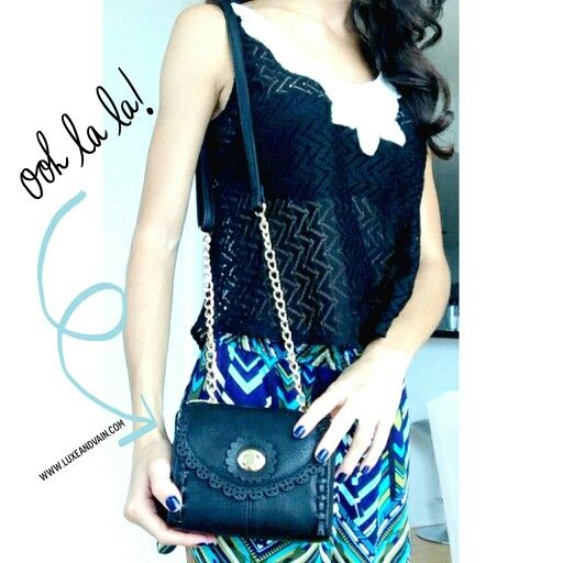 Stay lovely with this cute black vegan crossbody purse from luxeandvain.com Goes great with chevron printed shirts and a black knit top